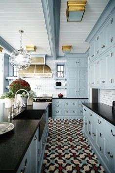 Light blue kitchen cabinets, black countertop