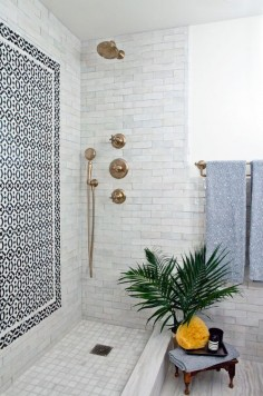 light gray tile with black and white mosaic
