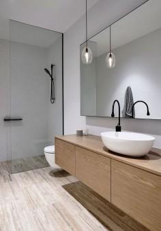 Lighting inside the white contemporary bathroom is kept minimal - Decoist