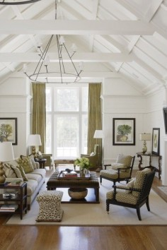 Living room. Soft green and white, a-frame ceiling.
