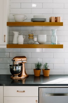 Love open shelving but not sure how to make it work for your kitchen? One of the easiest ways to keep the look in line is by displaying only those items you truly love. Odds are, you use them so often already that a door-less shelf makes them that much more convenient. [Featured Design: Fieldstone™]