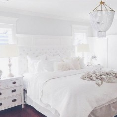 Love the chandelier, nightstands & white.