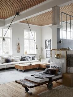 Love the coffee table -interior design loft sweden