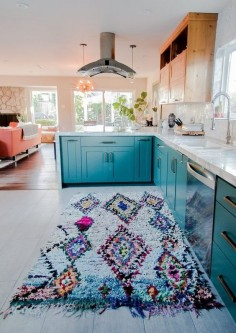 Love the color of the cabinets and the coral furnishings.