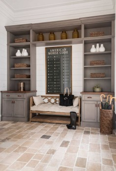 Mudroom. Mudroom features limestone floor tiles and graywashed cabinets. #mudroom #Mudroomcabinet #Mudroomfloortiles #Mudroomflooring #graywash #limestonetiles  Palmetto Cabinet Studio