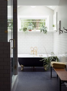 navy tiles, black clawfoot tub, and white subway tile