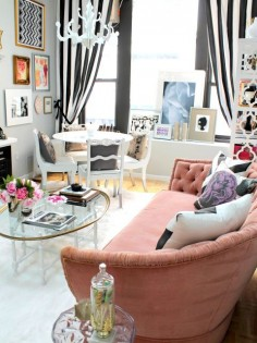 Nichole Loiacono Design | NYC Fashion PR Office. Striped drapes, tufted sofa and bold black and white pillows