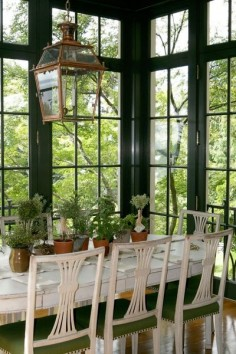 painted chairs, wall of windows, lantern fixture.