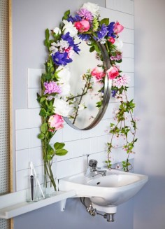 Picture of a garland of flowers around a bathroom mirror