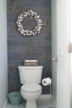 Plank wall stained in Minwax classic gray
