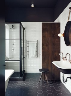 Renovated Montreal bathroom with black and white Ceragres tiles.