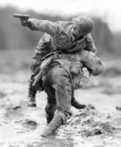 """Someone posted """"... never leave a man behind.""""  An amazing photo, I would like to know the details.  Cannot believe it isn't famous, ... or is it?"""