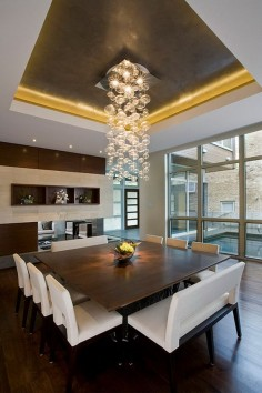 Square table and uber cool hanging light fixture/ Chandelier. Modern lighting. Wall of windows in the dining room. 40  Beautiful Modern Dining Room Ideas