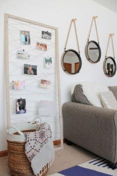 Staple or glue twine to the back of a thrifted frame, then use clothespins to hang up your prints. | 19 Gorgeous Ways To Display Your Favorite Travel Photos