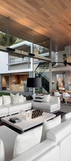 Stunning and very unique architecture. The use of vertical and horizontal lines makes it very modern. Also the organic design and large open windows bring the outside in.