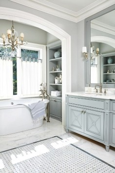 stunning powder blue/grey bathroom, painted vanity, joinery details, marble tiles, lights.