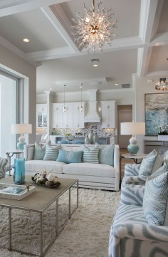 Susan J. Bleda and Amanda Atkins of Robb & Stucky created a coastal style interior in this Marco Island home by using a color palette of blues, aquas and natural browns accented by metallic silvers and grays -