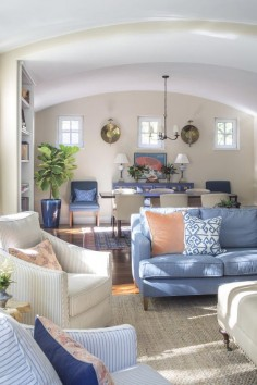 The living room and dining room were treated as a single space, using a strong color palette to tie it together