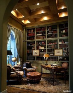 The man cave for guys who like to kick back and relax with some scotch and a good book. Click to see the right way to style a bookshelf.