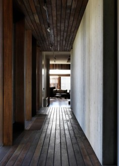 The materiality of the interior displays a connection to the surrounding environment through the use of the dark hardwood. In addition this hallway creates a private space within the house used only by the residence.