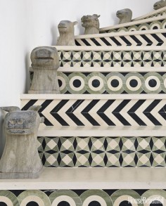 The staircase becomes a graphic installation with patterned tiles.