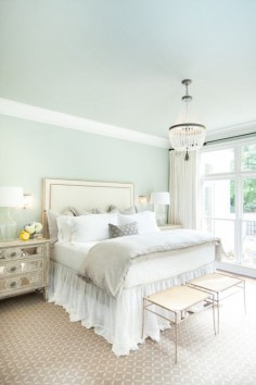 There is nothing more soothing than a bedroom draped in white and sea foam green.