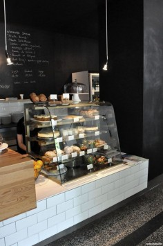 this i  lower wall at one end of the bar for the bakery case / cases, then the bar runs along the entire length.  and chalkboard paint on the walls, you could do a little area for kids to do chalk near the bakery case.
