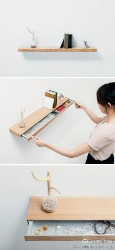 【书架的秘密抽屉】日本公司 Torafu 所设计的简约书架,外形起来就是一个木板迷惑了大众,当用两块磁吸像下图一样,就可以将隐藏的抽屉吸出来,可以放一些自己认为重要的物品,悄悄藏在其中。