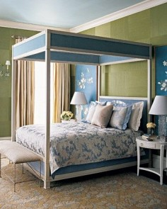 We all like to dream in Technicolor, yet many of us are reluctant to decorate a bedroom in anything but hushed neutrals and restful pastels. This room's unique color combination of teal blue and moss green is bold but beautiful. A floral pattern on the wall decorations, rug, and bedding pulls it all together.