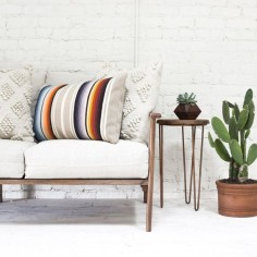 When it comes to decorating with color, this pillow set has you covered. The set includes one striped lumbar pillow and two richly textured cream pillows.