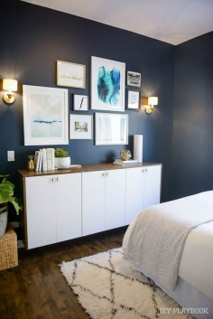 A bold wall color (like this moody navy!), looks great brightened up with white and gold accents from HomeGoods. Love the marble vase and white planter on top of the dresser. (Sponsored Pin)