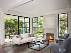Contemporary White Living Room With Tiled Fireplace
