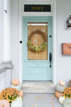 Farmhouse style fall porch decorating idea.