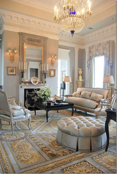 Lovely traditional design & a soft color scheme. Many attractive elements including the crown molding, beautiful draperies, & elegant furnishings. Siller/ Hokanson