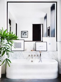 Modern bathtub in a black and white bathroom