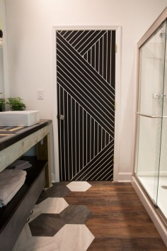 Paint a dramatic pattern on a standard builder grade door for striking visual impact.