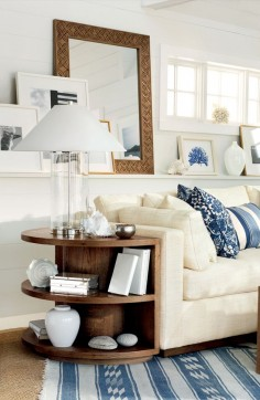 Ralph Lauren Home's Driftwood Sofa and nautical decor transform a living rom into a soothing retreat by the ocean