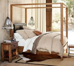 The classic four-poster bed gets updated with a sleek wood profile. The warm of the wood is only enhanced by the textured hand of the linen to create a bed that is a little classic, a little rustic but definitely stylish and comfortable.