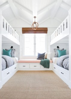 The homeowners wanted a fun retreat to house all their grandkids, and four built-in bunk beds proved the perfect solution. The kids' bedroom expertly incorporates the home's beach location into its design, so the space is just as beautiful as it is functional.