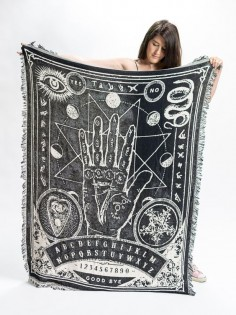 We want to wrap ourselves in this palmistry throw blanket right NOW.