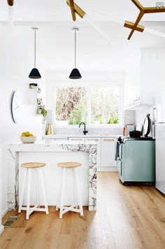 While super-modern kitchens are also very lovely, lately we've been seeing a lot of stylish kitchens that incorporate one or more vintage elements. Whether it's a vintage-style stove or refrigerator or a antique pie safe, adding something old (or something that just looks old) to your kitchen will give it an intriguing dose of texture and history.