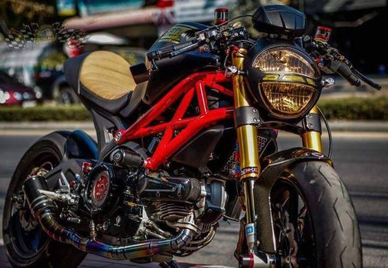 Black Ducati Monster with a custom seat, tinted headlights ...