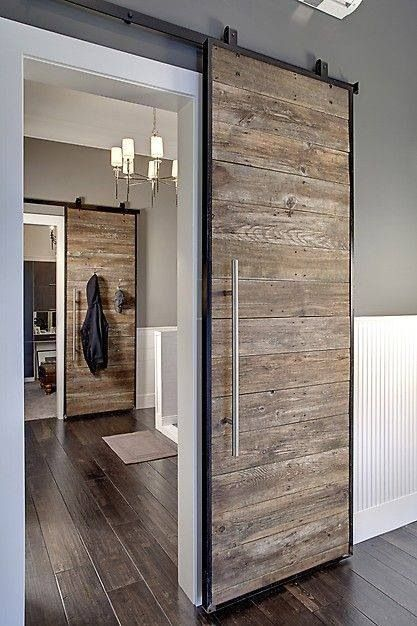 Sliding wooden doors is a great way to add rustic to a modern home. Love this interior design