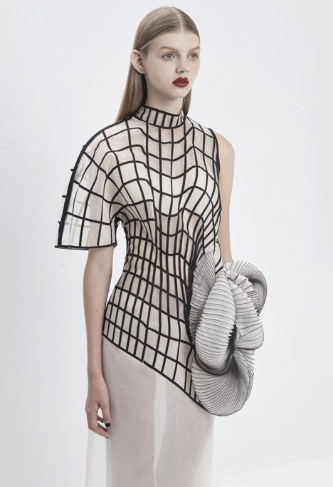 This is a good example of LINES. The lines in this outfit create boxes that change shape and width, creating movement within. Your eyes are automatically drawn to the lines in this piece, almost more so than to the 3-D shape. The lines in this create depth throughout the top.