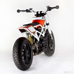 Ducati Multistrada by Ad Hoc - Fat bars, bar ends, imagination, and 1000cc of skinny bike