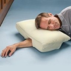 This is so  Arm Sleepers Pillow - Hammacher Schlemmer