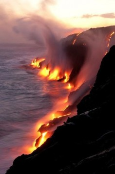Where fire & water  6 miles southwest of Kalapana on Big Island, Hawaii, USA.