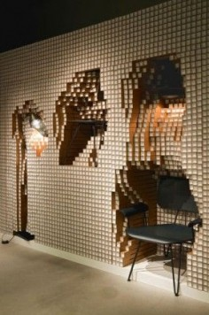 A modular wall made from 10,000 paper pipes that encapsulates furniture