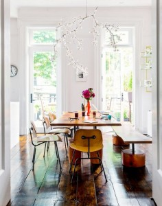 Bright dining space with bench seating and a wood table