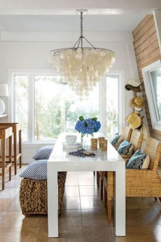 Coastal dining room with a shell chandelier